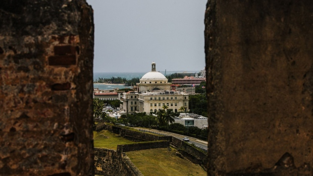 The Capitol Building is seen past walls in the Old City of San Juan, Puerto Rico. Photographer: Christopher Gregory