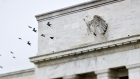 Birds fly past the Marriner S. Eccles Federal Reserve Board building in Washington, D.C. Photographer: Joshua Roberts/Bloomberg