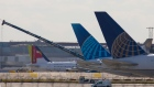 The tail fins of a passenger aircraft, operated by United Airlines Holdings Inc., sit on the tarmac tail-fins sit at London Heathrow Airport in London, U.K. on Monday, March 16, 2020.