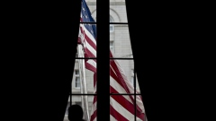 An American flag flies outside the Environmental Protection Agency (EPA) headquarters in Washington, D.C., U.S., on Wednesday, July 11, 2018. EPA Acting Administrator Andrew Wheeler promised today to defend workers, heed their advice and protect the environment in his first address to employees since taking the helm of the agency from embattled former chief Scott Pruitt. Photographer: Andrew Harrer/Bloomberg