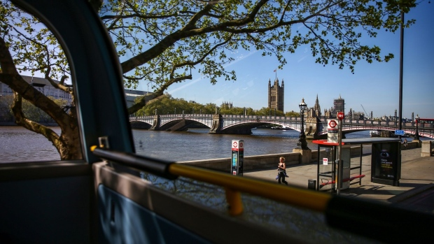 The Houses of Parliament stand in this view from inside a bus in London. Photographer: Hollie Adams/Bloomberg