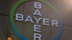 The Bayer AG logo sits on the exterior of the company's pharmaceutical factory in Berlin, Germany, on Wednesday, March 20, 2019.