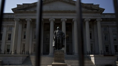 A statue of Albert Gallatin, former U.S. Treasury secretary, stands outside the U.S. Treasury building in Washington, D.C., U.S., on Monday, July 16, 2018. The House this week plans to consider a minibus spending bill that combines legislation funding the Treasury, Internal Revenue Service (IRS), and the Securities and Exchange Commission (SEC) with another bill keeping the Interior Department and Environmental Protection Agency (EPA) running. Photographer: Andrew Harrer/Bloomberg