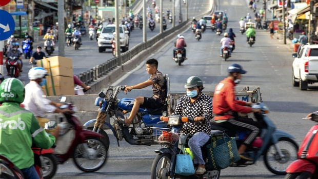Traffic travels along a road during a nationwide social distancing and stay-at-home order imposed due to coronavirus in Ho Chi Minh City, Vietnam, on Wednesday, April 22, 2020. Vietnam's social distancing order is easing on April 23 for most of the country just ahead of next week's four-day holiday. Prime Minister Nguyen Xuan Phuc told authorities in cities and provinces to decide which businesses can reopen, according to a statement on the government's website. Photographer: Maika Elan/Bloomberg