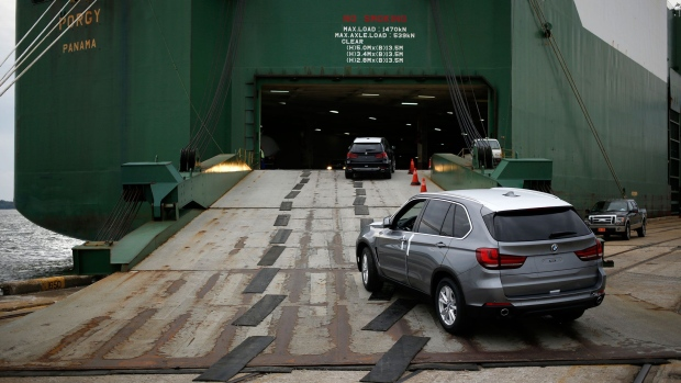 Bayerische Motoren Werke AG (BMW) vehicles, assembled in the U.S., are driven onto the Wallenius Wilhelmsen Logistics AS Porgy vehicle carrier ship at the Port of Charleston in Charleston, South Carolina, U.S., on Tuesday, Oct. 4, 2016. The U.S. Census Bureau is scheduled to release wholesale trade figures on October 7. Photographer: Luke Sharrett/Bloomberg