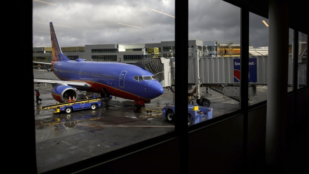 A Southwest aircraft stands on the tarmac at San Francisco International Airport. Photographer: Patrick T. Fallon/Bloomberg