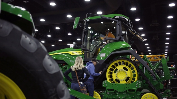 Attendees examine a Deere Co. John Deere tractor at the National Farm Machinery Show in Louisville, Kentucky, U.S. on Friday, Feb. 14, 2020. The show offers a selection of cutting-edge agricultural products, equipment and services available in the farming industry. Photographer: Luke Sharrett/Bloomberg