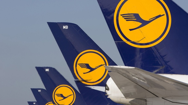 The Deutsche Lufthansa AG logo sits on tailfins of Boeing Co. 747 jets and Airbus A380 aircraft as they stand on the tarmac outside terminal A-plus at Frankfurt Airport, operated by Fraport AG, in Frankfurt. Photographer: Martin Leissl/Bloomberg