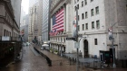 Rain falls over the New York Stock Exchange (NYSE) in New York, U.S., on Tuesday, April 21, 2020. Treasury futures ended Tuesday mixed, with front-end yields slightly cheaper on the day and rest of the curve richer, yet off session lows reached during U.S. morning. Photographer: Michael Nagle/Bloomberg