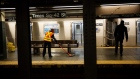 A Metropolitan Transit Authority (MTA) worker mops around a bench at a Times Square subway station in New York on April 21. Photographer: Michael Nagle/Bloomberg
