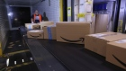 The Amazon.com Inc. logo sits on boxes moving along a conveyor into a truck dock ahead of shipping from an Amazon.com Inc. fulfilment center during the online retailer's Prime Day sales promotion day in Koblenz, Germany, on Monday, July 15, 2019. Amazon is tapping high-profile actors, athletes and social-media sensations like never before to maintain buzz around its Prime Day summer sale, now in its fifth year and battling increasing competition from rivals. Photographer: Krisztian Bocsi/Bloomberg