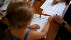 Lois Copley-Jones, aged 5, daughter of the photographer does school work with her mother at home after her parents decided to stay at home rather than go back to school on June 01, 2020 in Newcastle Under Lyme, UK.