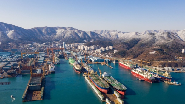 Ships sit under construction at the Daewoo Shipbuilding & Marine Engineering Co. shipyard in this aerial photograph taken in Geoje, South Korea, on Friday, Feb. 1, 2019. Hyundai Heavy Industries Group and Daewoo Shipbuilding's largest shareholder Korea Development Bank (KDB) signed a conditional MOU under which Hyundai Heavy Industries Co. will split into a holding company and an operating company. The holding company will buying KDB's 55.7 percent stake in Daewoo. Photographer: SeongJoon Cho/Bloomberg