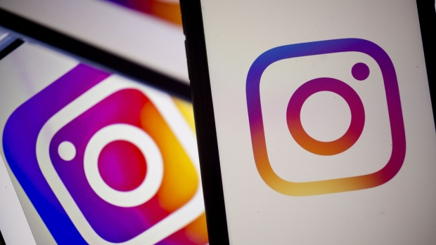The Facebook Inc. Instagram logo is displayed on an Apple Inc. iPhone in an arranged photograph taken in Arlington, Virginia, U.S. on Monday, April 29, 2019. Facebook's sales gains are increasingly being driven by photo-sharing app Instagram and advertising in its Stories feature, a Snapchat copycat. Photographer: Andrew Harrer/Bloomberg