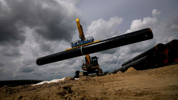 An excavator lifts a section of pipe on the European Gas Pipeline Link (EUGAL) site, a joint construction project by Sicim SpA and Bohlen & Doyen GmbH, in Gellmersdorf, Germany, on Tuesday, May 28, 2019. One of Europe's biggest natural gas users has turned decidedly pessimistic on the fuel, prompting traders to rethink their own outlook for the industry. Photographer: Krisztian Bocsi/Bloomberg