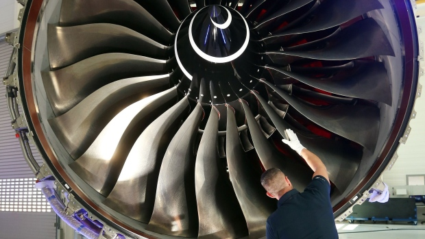 An employee inspects a Rolls-Royce Trent XWB engine in Berlin. Photographer: Adam Berry/Getty Images