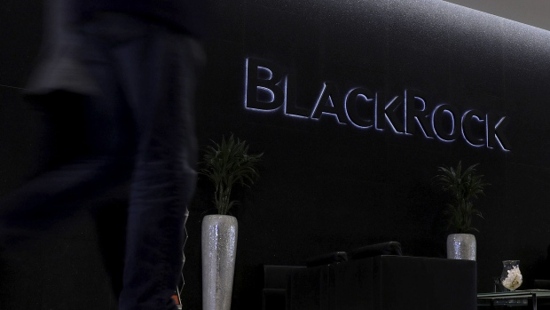 A logo sits on display in the atrium of the Blackrock Inc. offices in London. Photographer: Simon Dawson/Bloomberg