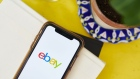 "The logo for eBay Inc. is displayed on a smartphone in an arranged photograph taken in the Brooklyn borough of New York, U.S., on Sunday, May 10, 2020. There has been ""a meaningful structural change"" in U.S. retail, with more and more money shifting to e-commerce during the pandemic, according to Baird. Photographer: Gabby Jones/Bloomberg"