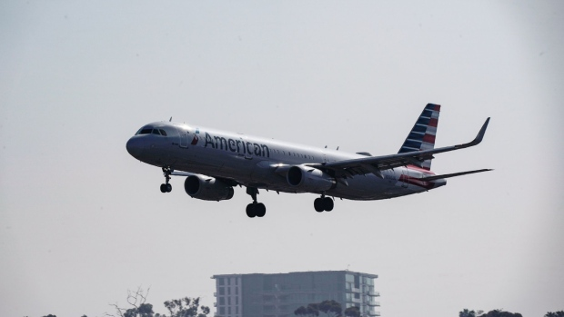 An Airbus SE A321 aircraft, operated by American Airlines Group, flies into the San Diego International Airport (SAN) in San Diego, California, U.S., on Monday, April 27, 2020. U.S. airlines reached preliminary deals to access billions of dollars in federal aid, securing a temporary lifeline as the industry waits for customers to start flying again. Photographer: Bing Guan/Bloomberg