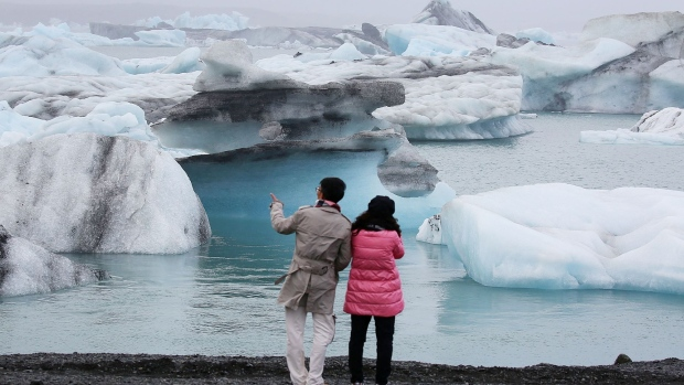 JOKULSARLON, ICELAND - JUNE 09: Visitors enjoy the view of Icebergs that calved from glaciers on June 3, 2017 in Jokulsarlon, Iceland. Iceland's tourism industry continues to thrive; just eight years ago Iceland welcomed approximately 464,000 tourists and by last year nearly 1.7 million people visited the nation. (Photo by Joe Raedle/Getty Images) Photographer: Joe Raedle/Getty Images Europe