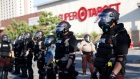 Minnesota State Police protect a Target Store Thursday, May 28, 2020, in St. Paul, Minn.