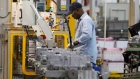 In this May 10, 2011 photo an autoworker assembles a transmission at the General Motors Transmission