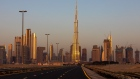 An empty highway leads towards the Burj Khalifa skyscraper, center, and other office buildings on the city skyline during the coronavirus lockdown in Dubai, United Arab Emirates, on Friday, April 24, 2020. An investment firm backed by a member of Abu Dhabi's royal family agreed to buy a stake worth just over $1 billion in LuLu Group International, which runs one of the Middle East's largest hypermarket chains, according to people familiar with the matter. Photographer: Christopher Pike/Bloomberg