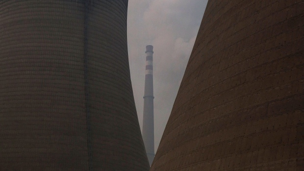 BEIJING, CHINA - NOVEMBER 27: A coal fired power plant is seen on November 27, 2015 on the outskirts of Beijing, China. China's government has set 2030 as a deadline for the country to reach its peak for emissions of carbon dioxide, what scientists and environmentalists cite as the primary cause of climate change.æ At an upcoming conference in Paris, the governments of 196 countries will meet to set targets on reducing carbon emissions in an attempt to forge a new global agreement on climate change. (Photo by Kevin Frayer/Getty Images)