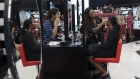 A sales assistant, second right, puts make-up on a customer at a Sephora USA Inc. store inside CapitaLand Ltd.'s Westgate Mall in Singapore, on Wednesday, Nov. 21, 2018. Online shopping in Singapore is lackluster even after Amazon Inc. debuted its Prime service in mid-2017. The island's malls are trying hard to keep it that way. Photographer: Wei Leng Tay/Bloomberg