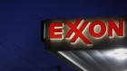Exxon Mobil Corp. signage is displayed at a gas station in Richmond, Kentucky. Photographer: Luke Sharrett/Bloomberg