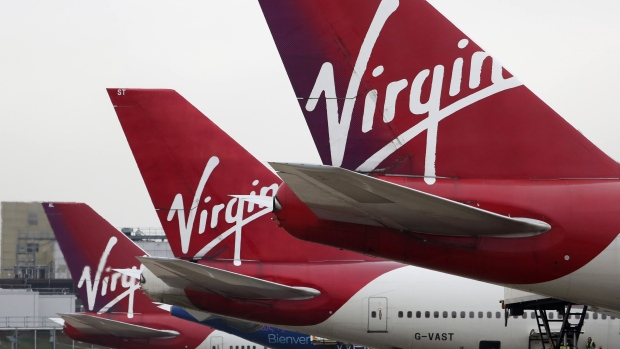 Logos sit on the tailfins of Virgin Atlantic aircraft at Gatwick airport in Crawley, U.K., on Thursday, Jan. 10, 2013.