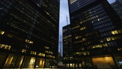 Office towers light up in the evening in the financial district of Toronto, Ontario, Canada, on Friday, May 22, 2020.