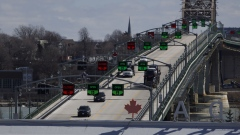 Traffic moves along the Peace Bridge border crossing between Canada and the U.S., in Fort Erie, Ontario, Canada, on Saturday, March 21, 2020.