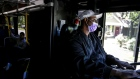 A bus driver wears a face mask in downtown Austin, Texas. Photographer: Bronte Wittpenn/Bloomberg