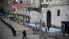 A pedestrian passes the the New York Stock Exchange (NYSE) in New York, U.S., on Wednesday, June 17