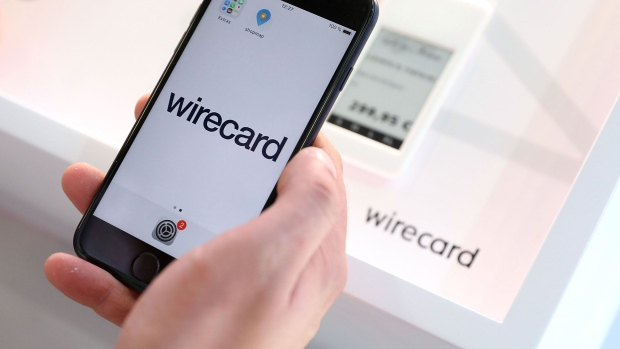 An employee demonstrates the Wirecard AG online payment smartphone app on the company's exhibition stand at the Noah Technology Conference in Berlin, Germany, on Thursday, June 13, 2019. The annual tech conference runs June 13 -14 and brings together future-shaping executives and investors.