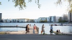 A group of people socialize on a jetty on the water's edge at Tantolunden in Stockholm, Sweden, on Friday, May 22, 2020