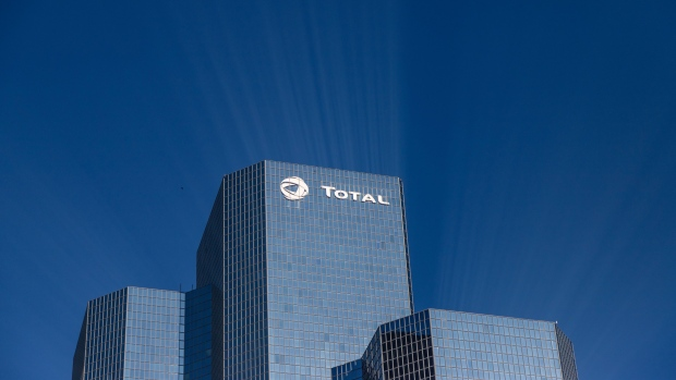 A logo sits on the exterior of the Total SA skyscraper headquarters in the La Defense business district in Paris, France, on Wednesday, Jan. 22, 2020. French Finance Minister Bruno Le Maire said he's hopeful for a compromise with the U.S. on digital tax to avoid a transatlantic trade war. Photographer: Anita Pouchard Serra/Bloomberg