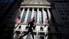 A jogger passes in front of the New York Stock Exchange (NYSE) in New York, U.S., on Wednesday, June 17, 2020. U.S. stocks fluctuated as the recent rally begins to show signs of losing momentum amid a worrying increase in coronavirus cases.