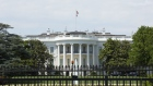 The White House stands behind perimeter fencing in Washington. Photographer: Stefani Reynolds/Bloomberg