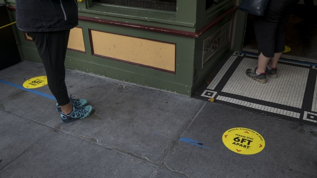 Social distance markers are displayed on the ground in front of a restaurant in San Francisco on June 15. Photographer: David Paul Morris/Bloomberg