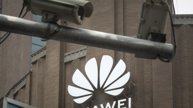 Public surveillance cameras are mounted to a pole in front of Huawei Technologies Co.'s new flagship store in Shanghai, China, on Wednesday, June 24, 2020. The store is Huawei's largest in the world, with a business area of nearly 5000 square meters, according to the company.