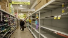 Empty shelves are seen in a grocery store in Toronto, Ontario, Canada, on Wednesday, March 25, 2020. The unemployment rate in Ontario, which accounts for almost 40% of Canada's output, was running at close to a record low before the province ordered all but essential businesses to shut down in a bid to contain the virus. Ontario now sees zero growth for this year.