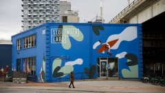 A pedestrian walks past Sidewalk Labs headquarters near the proposed site of 'Quayside' in Toronto, Ontario, Canada, on Thursday, May 7, 2020. Sidewalk Labs LLC, Alphabet's urban innovation unit and sister to Google, is shelving its plan to build an urban digital neighborhood due to unprecedented economic uncertainty globally and in the Toronto real estate market, Chief Executive Officer Dan Doctoroff said in a blog post Thursday.