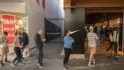Customers stand in line outside a Nike Inc. store during a partial lockdown imposed due to the coronavirus in Perth, Australia, on Saturday, May 9, 2020.