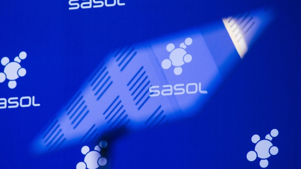 An autocue screen reflects the logo of Sasol Ltd. during a news conference at the company's headquarters in Johannesburg, South Africa, on Monday, Aug. 21, 2017. Sasol, the world's biggest producer of liquid fuel from coal, projects an internal rate of return of 7 percent to 8 percent at Lake Charles, which will convert ethane into plastics and other products. Photographer: Waldo Swiegers/Bloomberg
