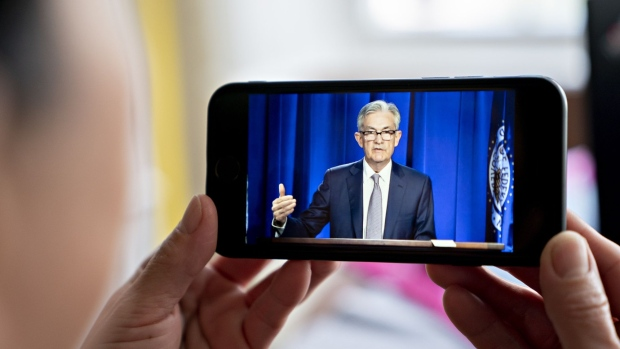Jerome Powell, chairman of the U.S. Federal Reserve, speaks during a virtual news conference seen on a smartphone in Arlington, Virginia, U.S., on Wednesday, June 10, 2020. The Federal Reserve put a floor under its large-scale asset purchases and projected interest rates will remain near zero through at least 2022 as policy makers seek to speed the economy's recovery from the coronavirus recession.