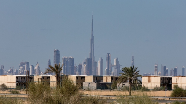 Abandoned buildings stand on the city perimeter beyond the Burj Khalifa skyscraper, center, and other skyscrapers on the city skyline in Dubai, United Arab Emirates, on Saturday, Dec. 21, 2019. Dubai's spending will surge next year as it prepares for World Expo 2020, according to the budget the government approved on Sunday.