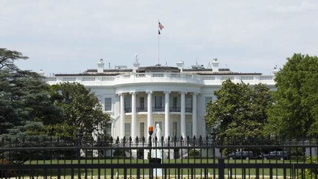 The White House behind perimeter fencing in Washington. Photographer: Stefani Reynolds/Bloomberg