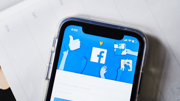 The Facebook Inc. website is displayed on an Apple Inc. iPhone in this arranged photograph taken in the Brooklyn borough of New York, U.S., on Monday, April 22, 2019. As Facebook Inc. prepares to report first-quarter results Wednesday, analysts are confident that the social-media company has moved past negative headlines that dogged the stock throughout the second half of 2018 and is positioned to monetize its massive user base in new ways. Photographer: Gabby Jones/Bloomberg
